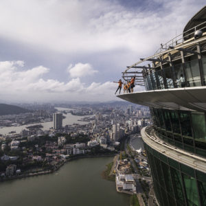 People visit the Skywalk feature at the Macau Tower in Macau, China.
